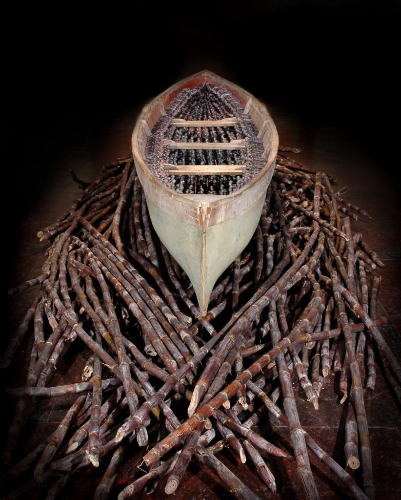 THEIR SPIRITS GONE BEFORE THEM, 2006, canoe, 1,357 resin figures, sugar cane, 22 x 9 x 3 ft. POR
